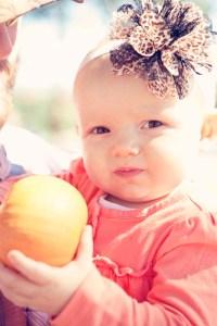 Baby Holding Pumpkin