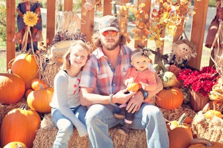 Daddy and his girls at pumpkin patch